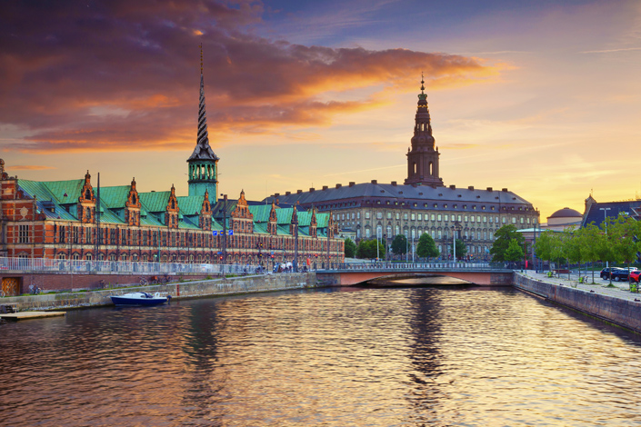 Copenhagen - A view across the canal to the Børsen Stock Exchange and Christiansbor Palace